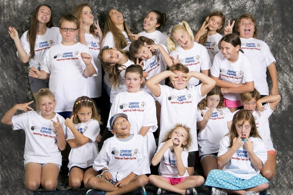 a bunch of kids making silly faces toward the camera