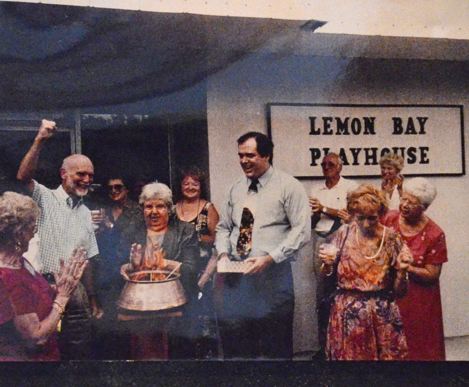 group of people standing in front of Lemon Bay Playhouse celebrating