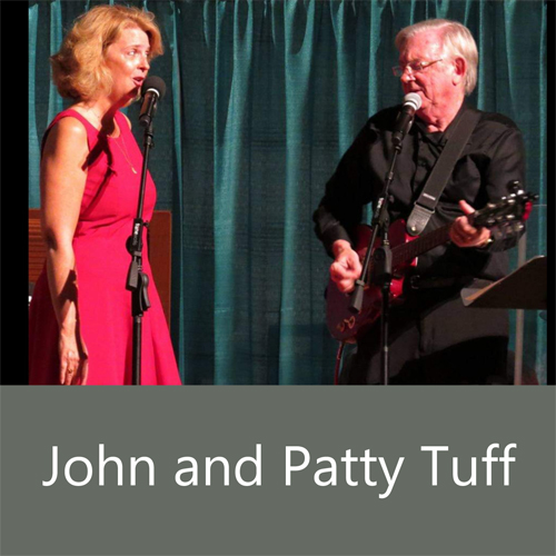 John and Patty Tuff - man playing guitar, woman sings into mic
