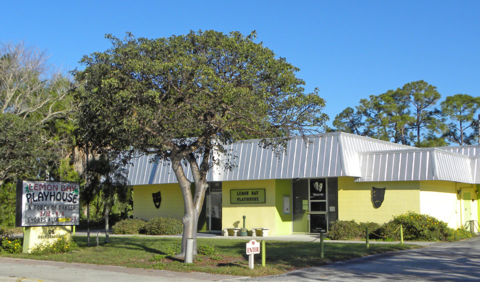 current photo of lemon bay playhouse building (one story metal roof building with yellow paint)